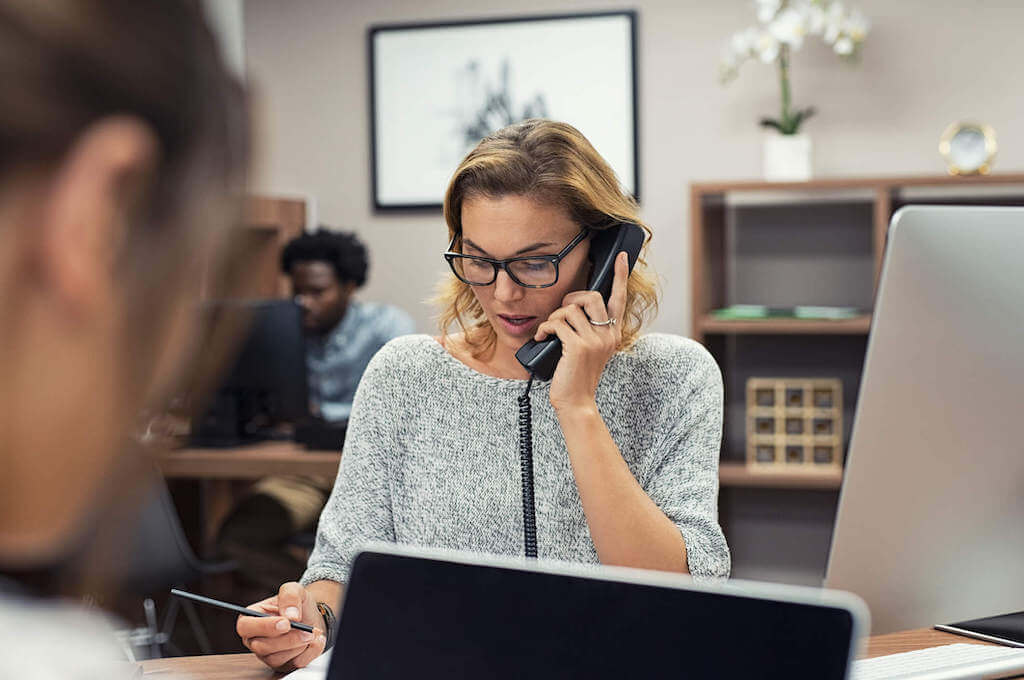 A woman works in a call center for a 3PL partner to provide customer service