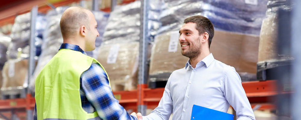 A business owner meets with a 3PL warehouse manager.